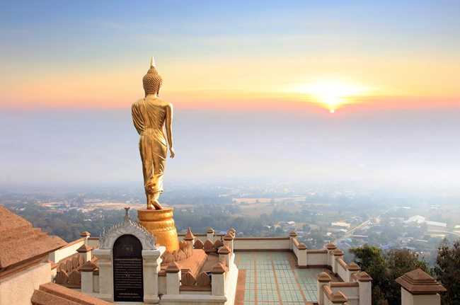 Things to do in Nan, Thailand: Gazing into the sun with the Blessing Buddha at Wat Phra That Khao Noi