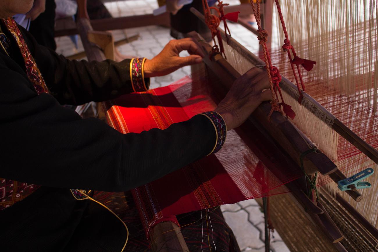 Thai textiles: Phu Tai woman weaving Phrae Wa silk in Kalasin