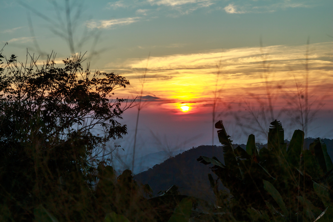 Things to do in Ratchaburi, Thailand: Sunrise over the mist on Khao Krajom