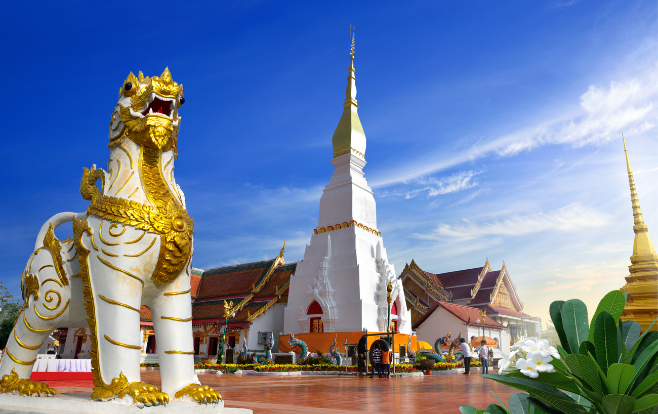 Things to do in Sakon Nakhon, Thailand: The stupa and guardian of Wat Phra That Choeng Chum